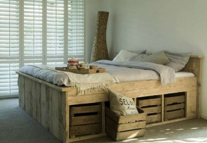 bed with wooden pallets
